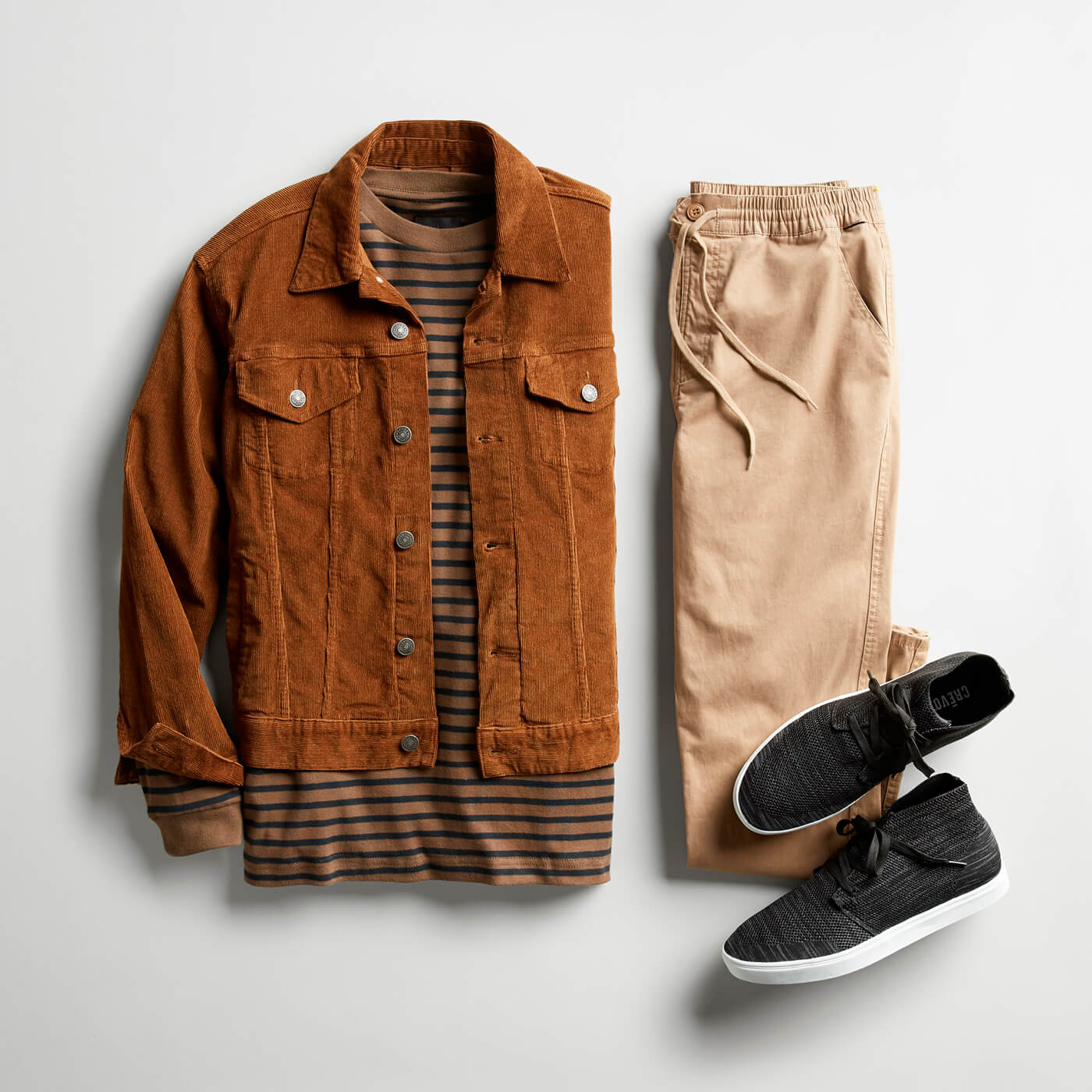 tan corduroy jacket and beige joggers