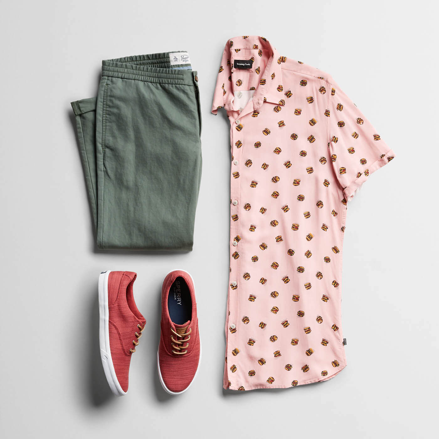 pink printed shirt and green chinos