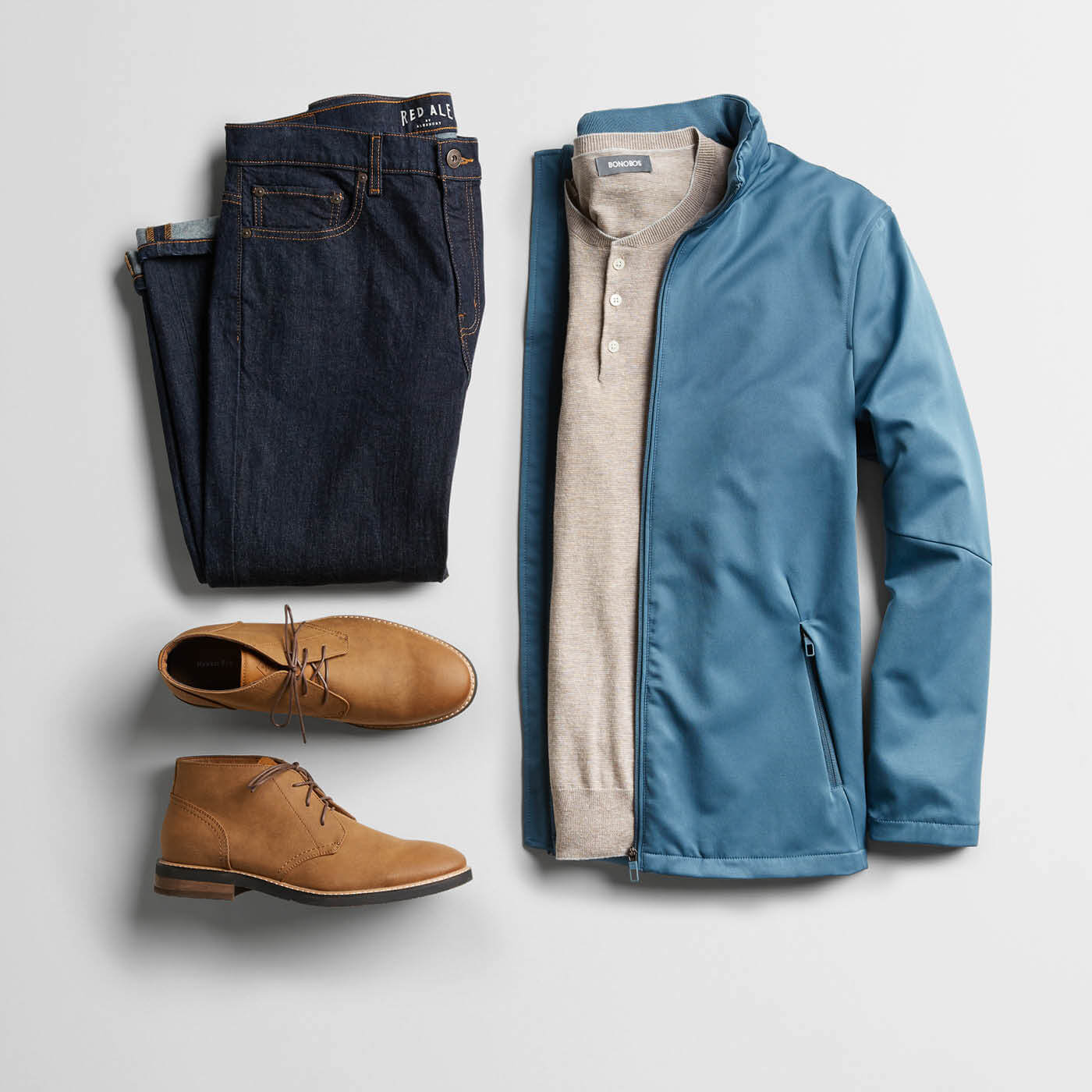 blue jacket, dark slacks and chukka boots